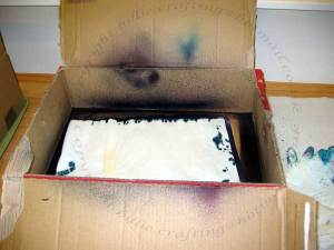 Cardboard box for spraying ink into