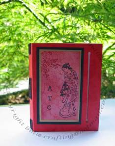 Longstitch book with oriental images and wrap around cover