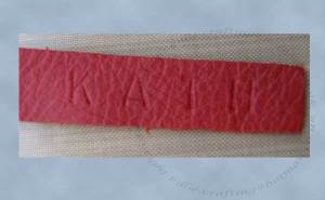 Detail of the name emboss stamped into the closure strap