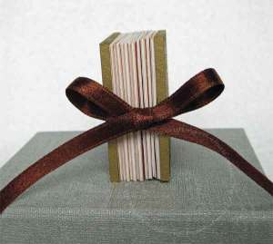 The book is held closed with a ribbon closure