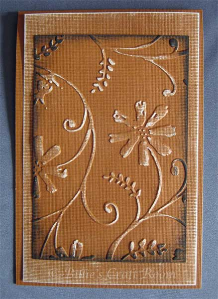 Sanded project. Embossed card with sanded base and main image.