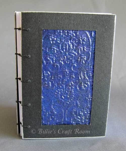 Coptic Stitched book with Fantasy Film Paper within an inset panel.