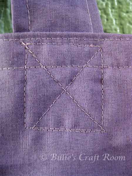 Close up of box stitch, securing the handles.