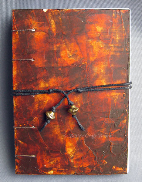 Coptic stitched handmade book, with dark wood effect covers