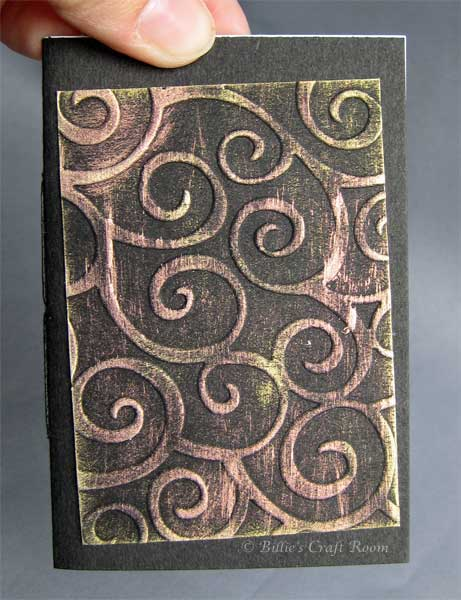 Embossed book with interference colours
