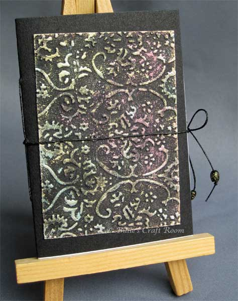 Embossed book with multi colours of interference acrylic paint