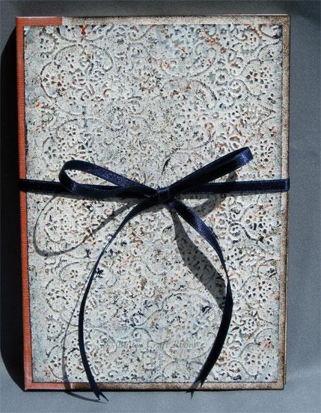 Embossed stone book