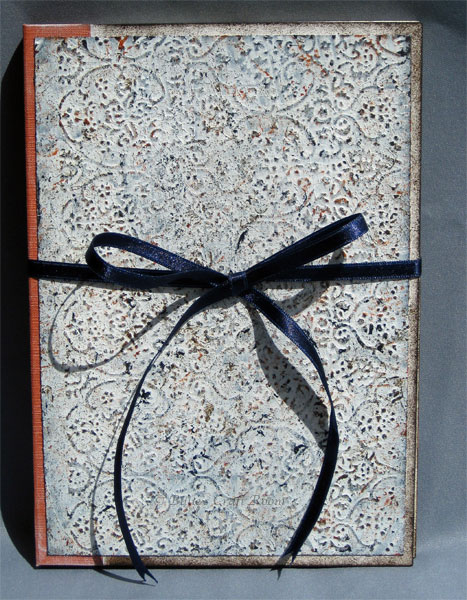 Embossed stone book