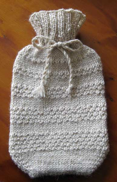 Hand knitted hot water bottle cover from 'The Little Knitting Company' kit.