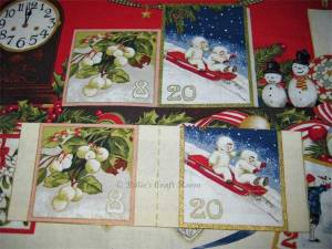 Advent calendar panel: Pockets ironed into shape and ready to sew on. Match them with the squares on the panel.