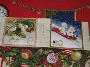 Advent calendar panel: Pockets with box pleats pinned in place and sewn along dotted line to form center of pleat first, this makes them secure.