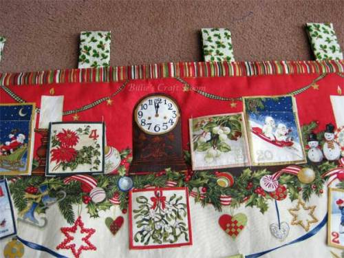 Advent calendar panel: Tabs to hang panel, pockets sewn in place and top stitched the edges to firm up the result.