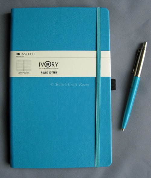 Terquoise book and Parker Jotter Pen.