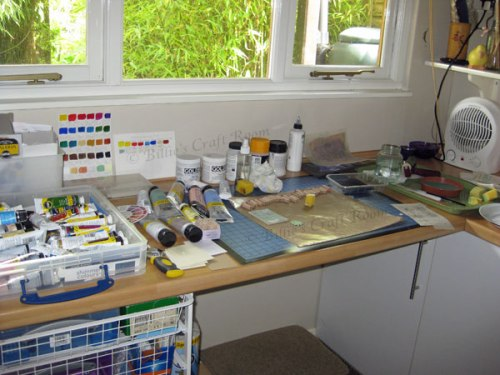 In the studio; my work desk, paint everywhere hehe